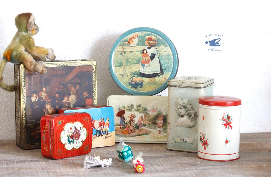 ベルギーのビスケットティン缶 お人形を抱く子供と猫 W19×H6.7cm gk-450